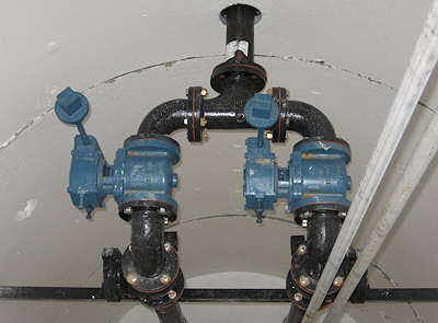 Top view of wet well with interior piping and valves.